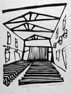 Black and white woodcut print using bold, expressionist lines to depict theater interior, seats, stage.