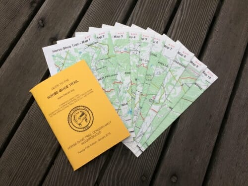 yellow guidebook with 10 color maps