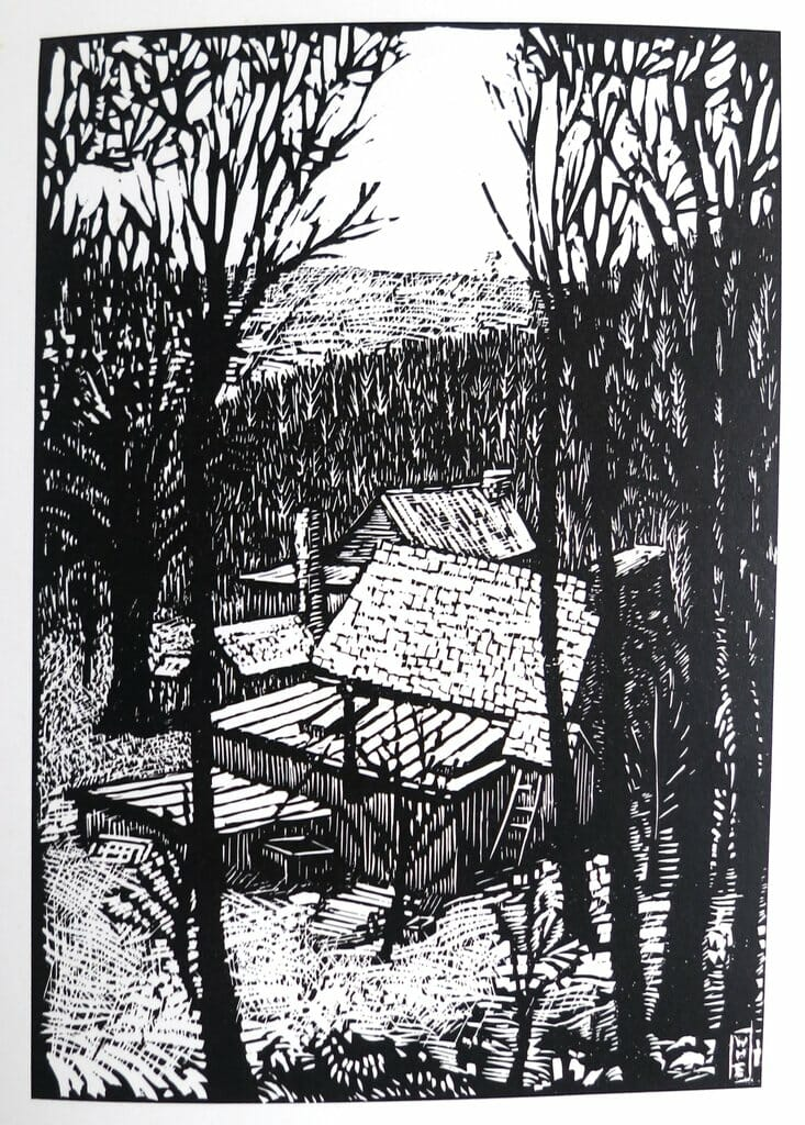 black and white woodcut image of barn down a hill beyond bare trees