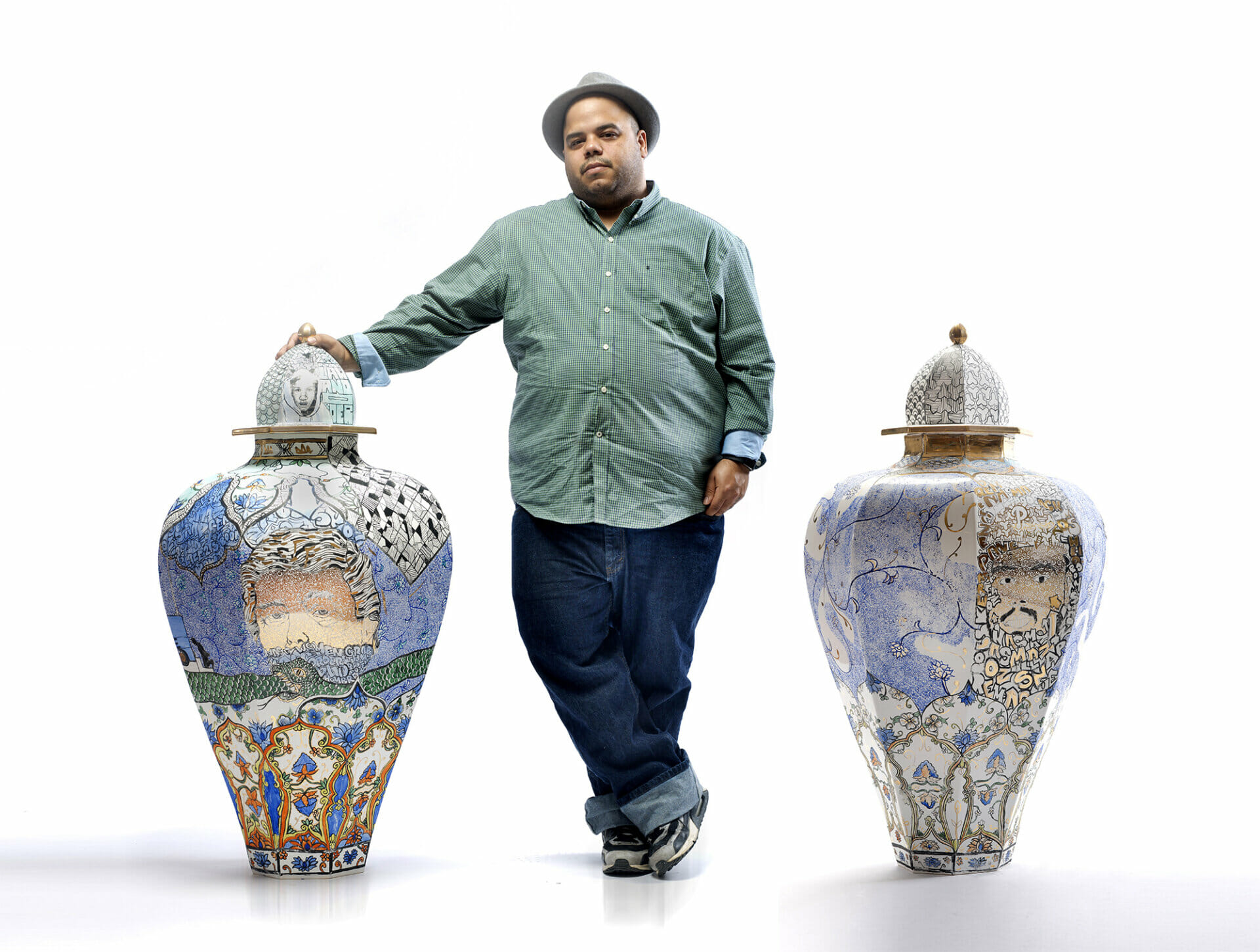 Man stand between two very large ceramic urns