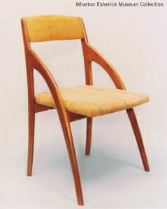 chair whose front legs arch up to meet the back of the chair well above the seat rather then ending at the seat.