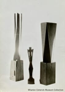 two wood lamps with crucifix in middle