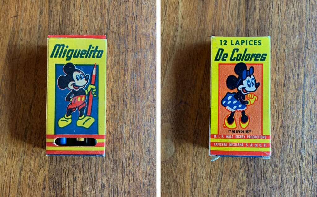 small colorful box with mickey Mouse and Minnie Mouse on it.