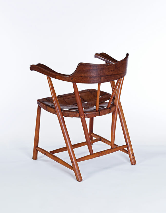 wood chair with armrests and laced leather seat