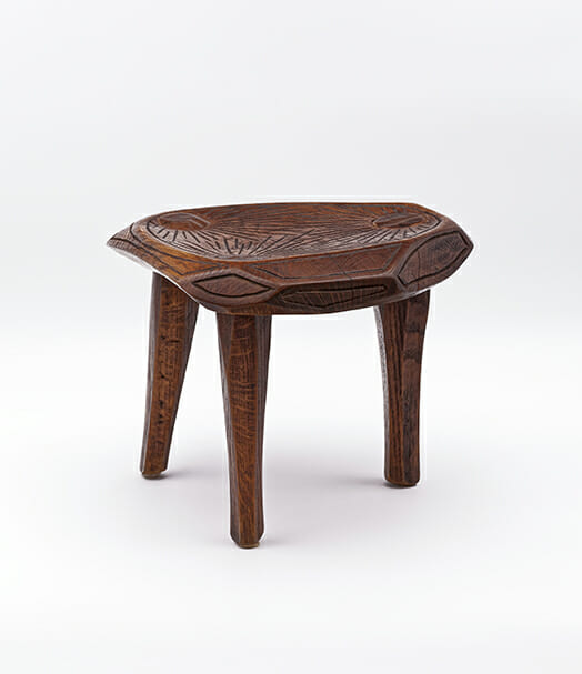 three legged wood stool