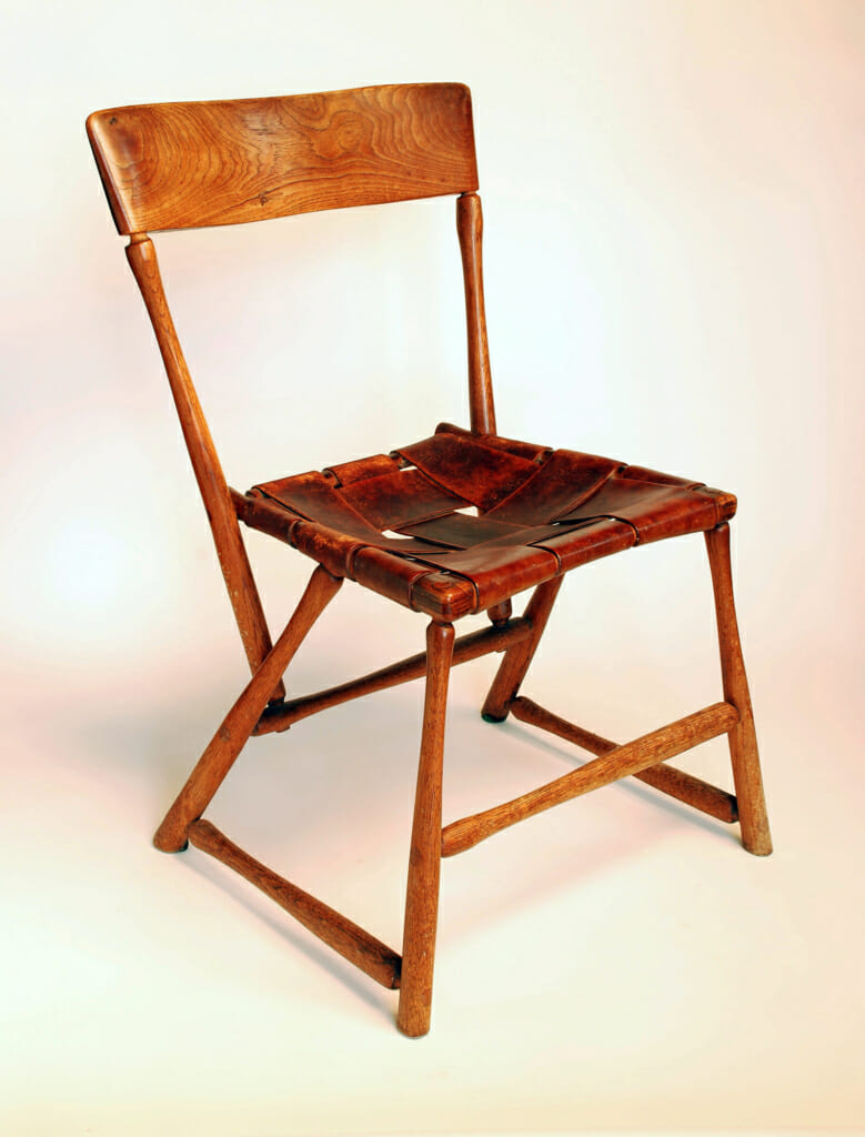 chair made from hammer handles with red painted laced canvas seat