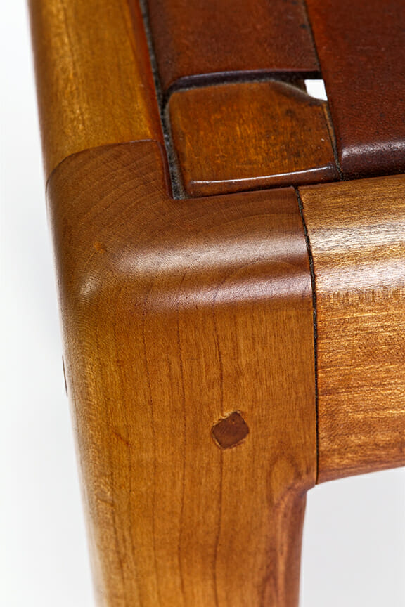 corner of chair seat where it where it meets leg showing mortise and tenon joint with squarish dowel