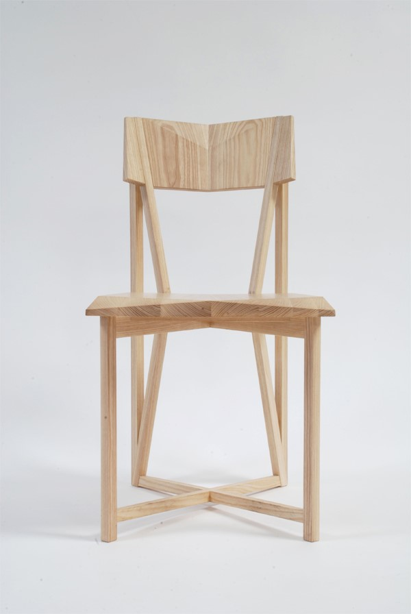 light wood chair with faceted geometric angles