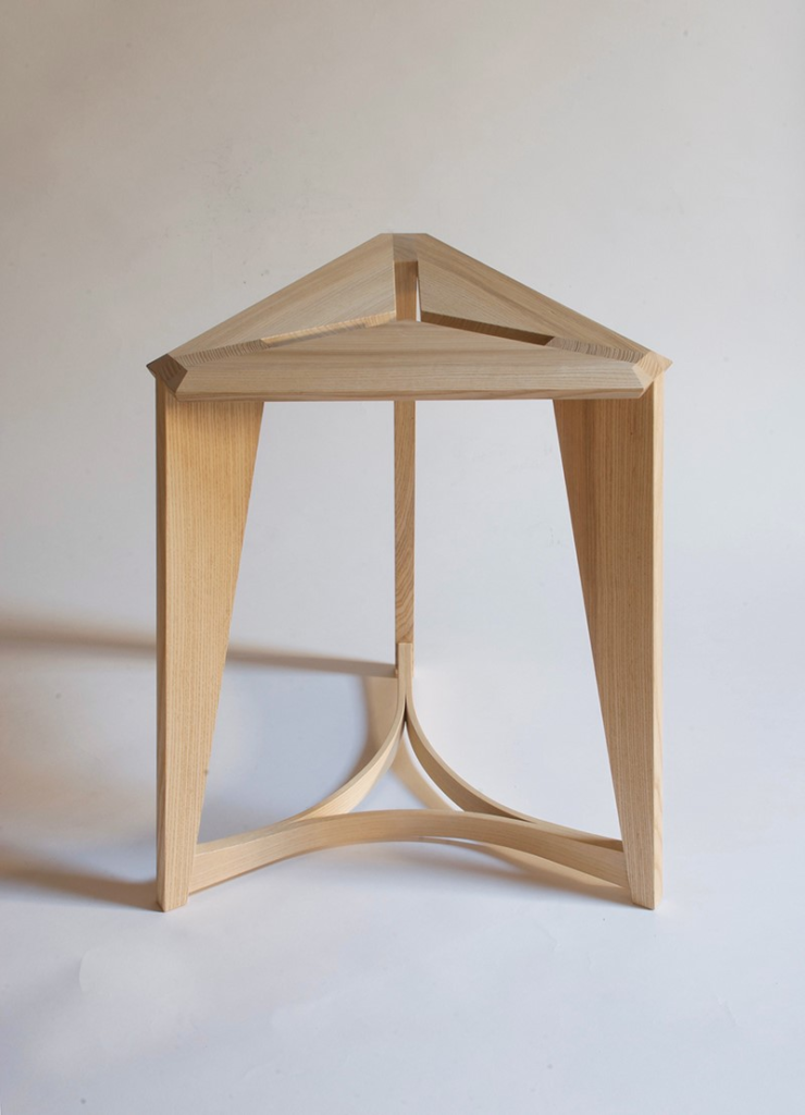 light wood triangular stool