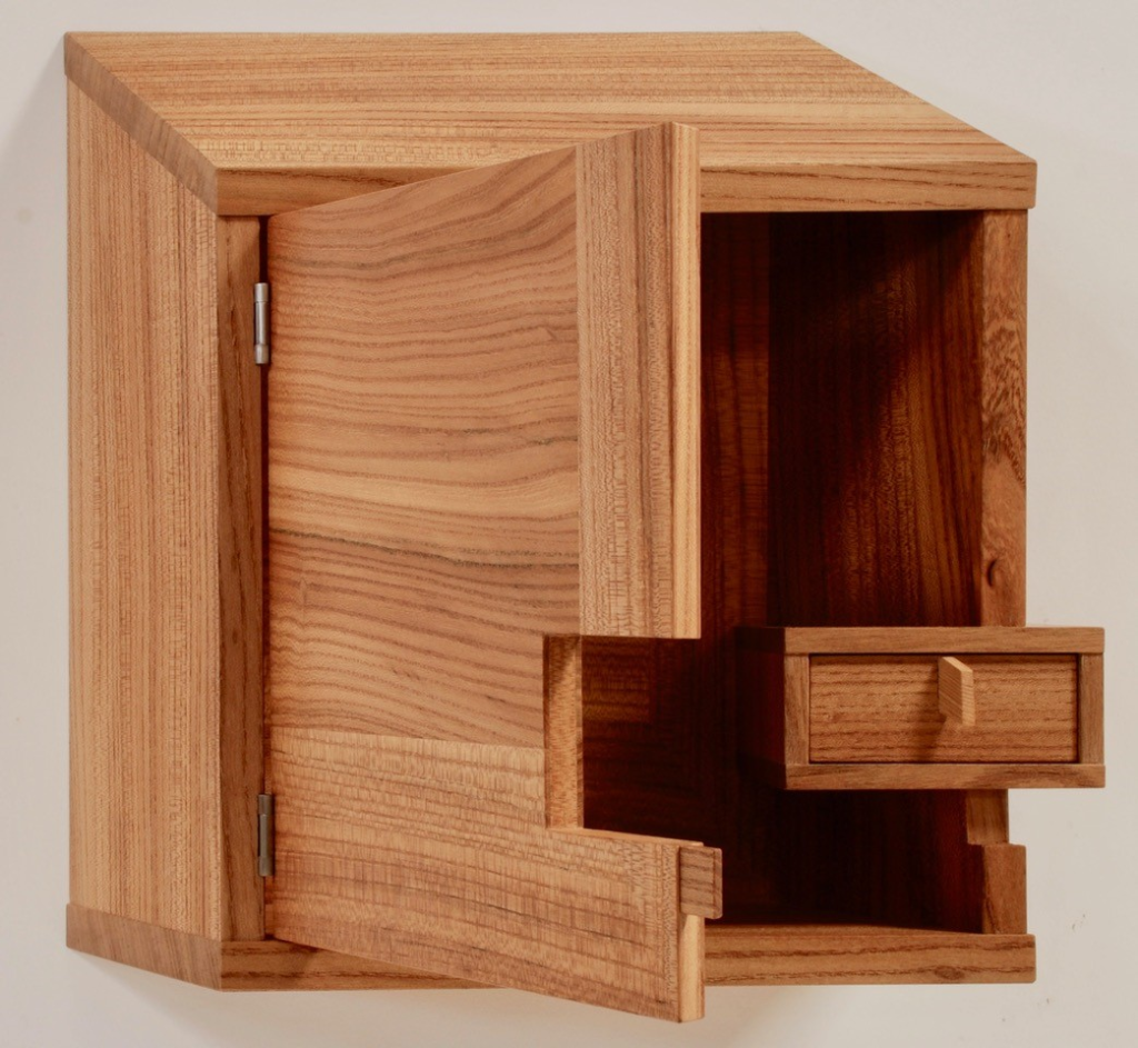 wood wall cabinet with inset drawer notched into door