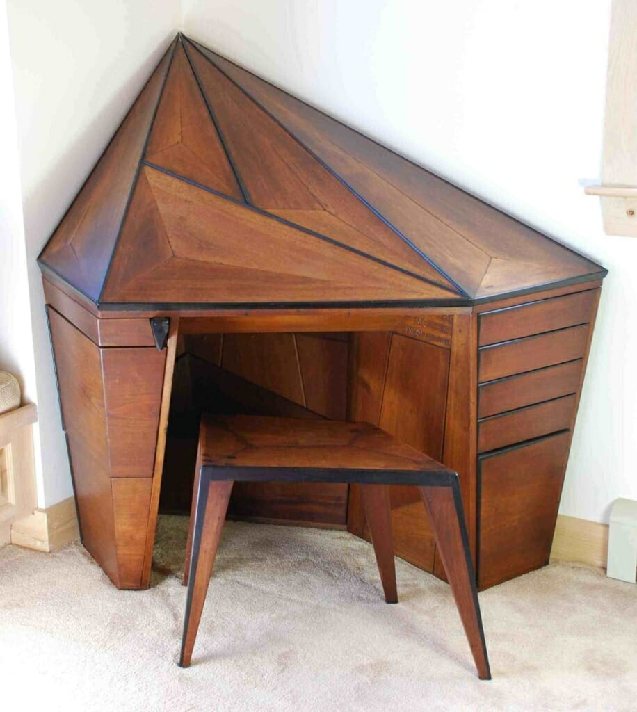 prismatic or faceted diamond shaped wooden corner desk with matching stool