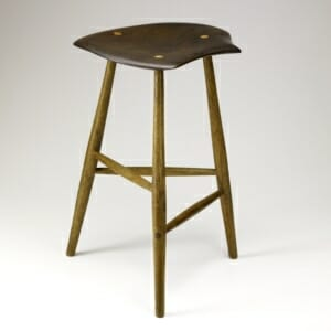wooden three legged stool with irregular free-form shaped seat