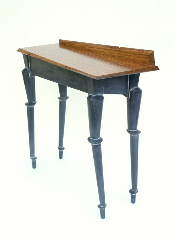 hall table with legs that appear jointed or precariously stacked, and a top that has askew angles