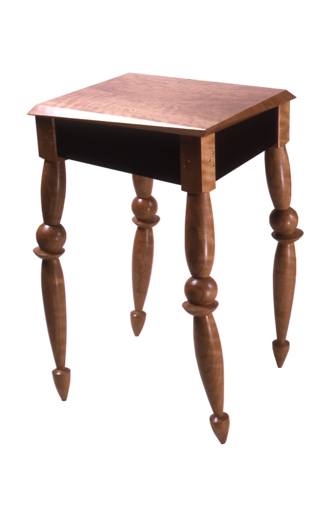 table with legs that appear jointed or precariously stacked, and a top that has askew angles