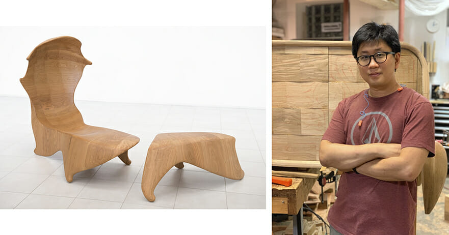 On the left we seen a wooden organic chair formwith a high curving back and a footstool. On the right we see a man with his arms folded acroos his chest wearing a faded red t-shirt and standing in a woodshop.