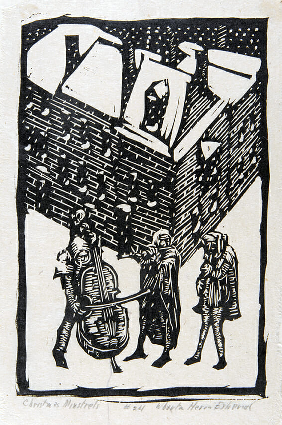 black and white woodcut of three musicians playing in the snow in front of a building