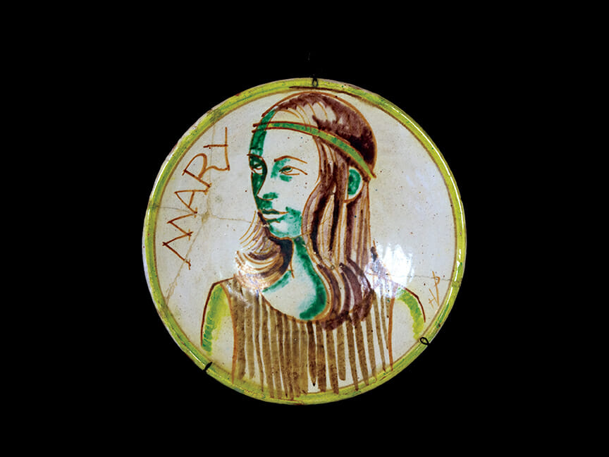 ceramic plate with portrait on girl with shoulder length hair and headband. Text on plate reads: Mary