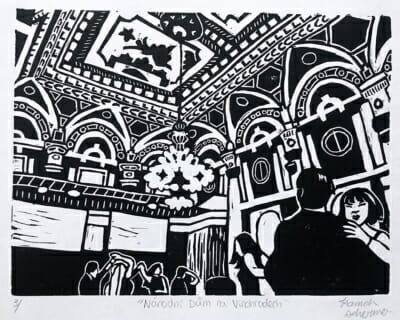black and white woodcut print depicts a beautiful and ornate ballroom ceiling. Out view is towards the ceiling with just the upper bodies of the dancers visable at the bottom of the page.