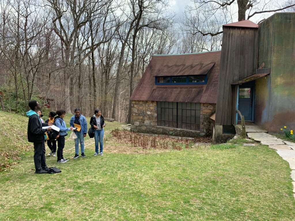 a group of students stand outside sketching the Esherick Studio