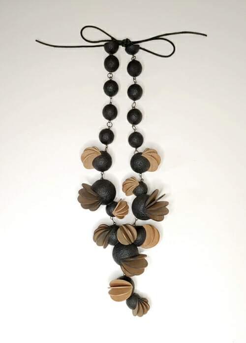 necklace with round wood balls and fanning petals