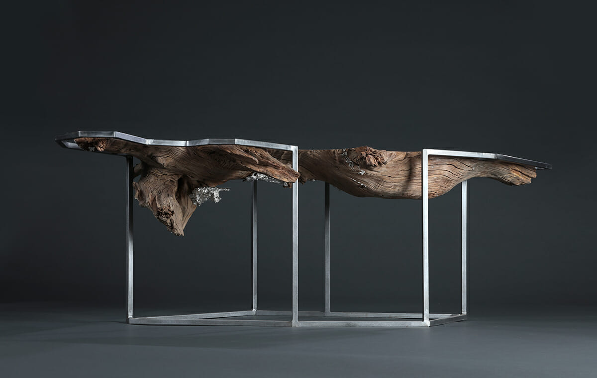 twisting wood form with rectilinear metal table frame
