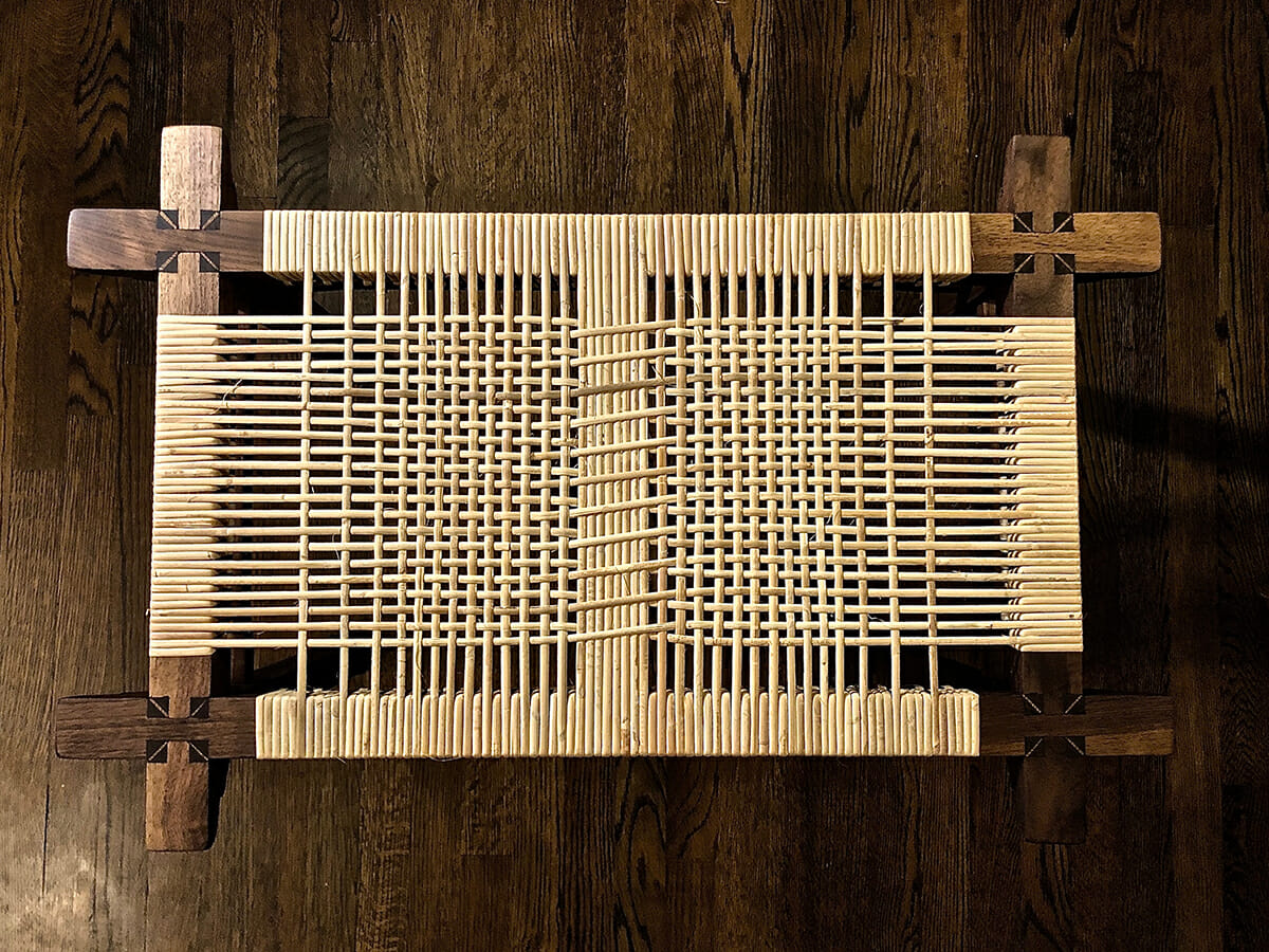 overhead view of caned rectangular bench