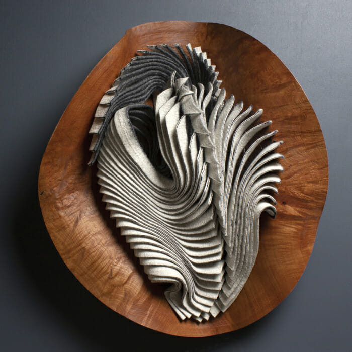 folds of fabric in a wood vessel