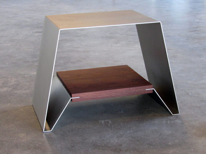 sheet of metal and wood formed to make a bench or stool