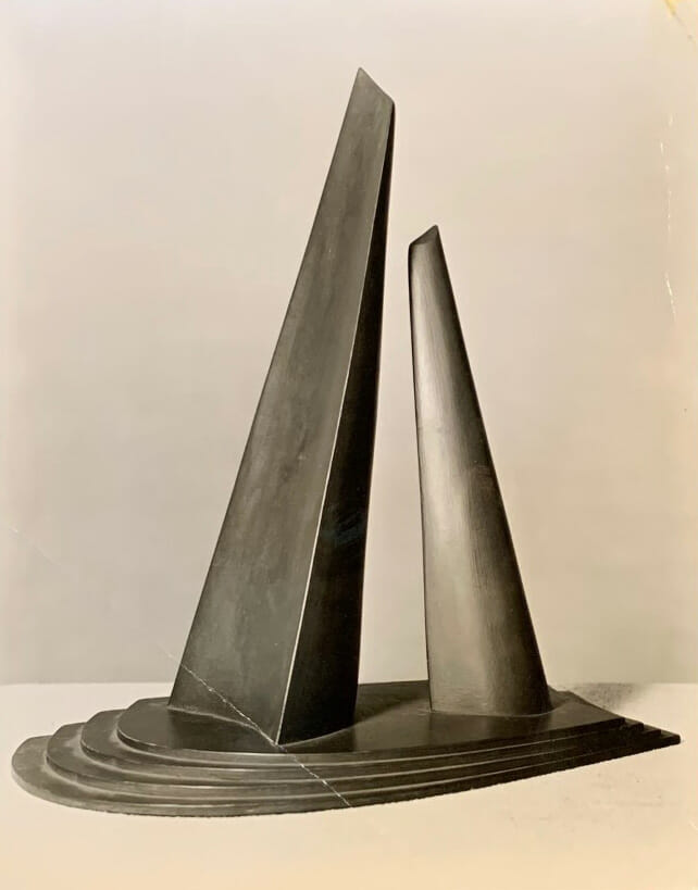 black and white photo of painted model for monument with two monoliths