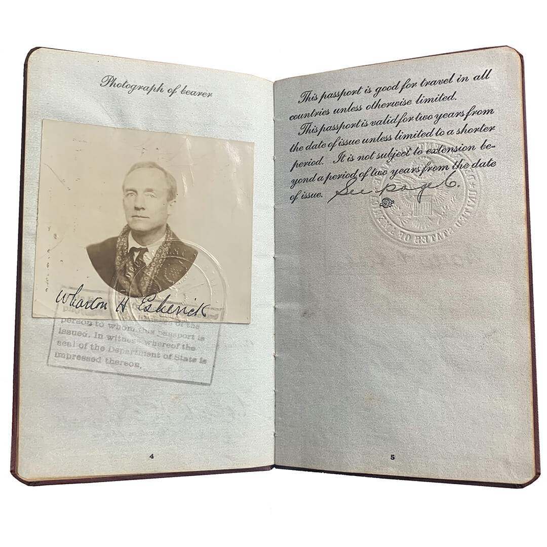 open passport booklet shows photo of Esherick wearing winter coat and fancy scarf, a stamp underneath, and passport text on the right.