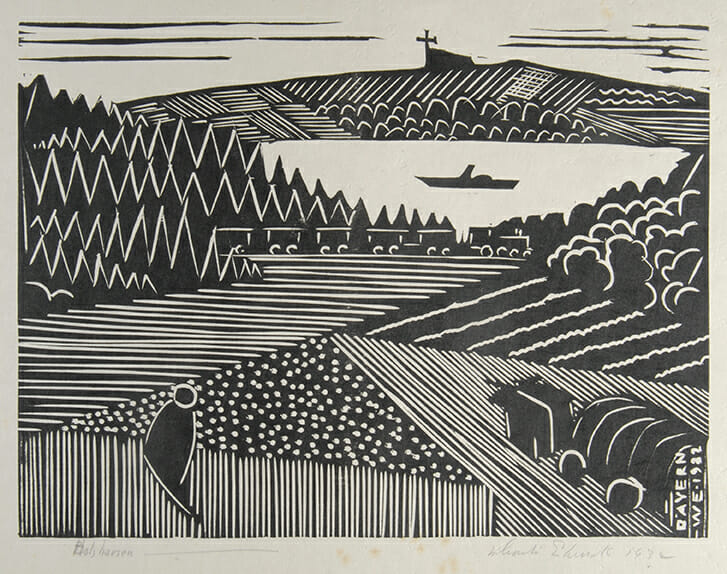 black woodcut print on white paper show a landscape depicted in angular, patterned styles. The is a figure and an ox-cart in the foreground and in the distance a train and a lake.